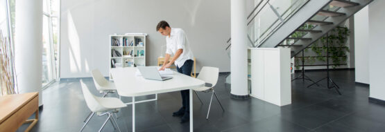 Man working on a table standing up